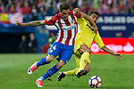 Jose Maria Gimenez of Atletico de Madrid competes for the ball with Jonathan Dos Santos of Villarreal during the match of La Liga between Atletico de Madrid and Villarreal at Vicente Calderon  Stadium  in Madrid, Spain. April 25, 2017. (ALTERPHOTOS/Rodrigo Jimenez)
