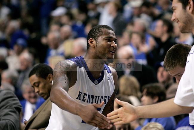 freshman forward DeMarcus Cousins and junior forward Josh Harrellson celebrate after John Wall's last dunk during the UK men's basketball game against Georgia at Rupp Arena on Saturday, Jan. 9, 2010. The Cats beat the Bulldogs 76-68. Photo by Adam Wolffbrandt | Staff