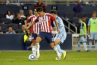 Arturo Ledesma (3)  Chivas Guadalajara defender gets in front of Soony Saad  Sporting KC forward... Sporting Kansas City played Chivas Guadalajara to a 2-2 tie at LIVESTRONG Sporting Park, Kansas City, Kansas in an international friendly.