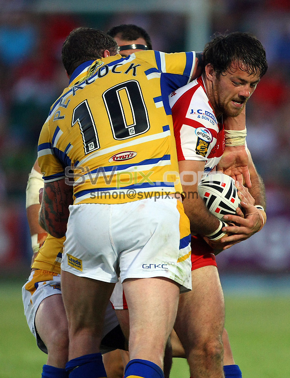 PICTURE BY VAUGHN RIDLEY/SWPIX.COM - Rugby League - Super League - Hull KR v Leeds - Craven Park, Hull, England - 09/07/10...Copyright - Simon Wilkinson - 07811267706...Leeds Jamie Peacock tackles Hull KR's Jason Netherton.