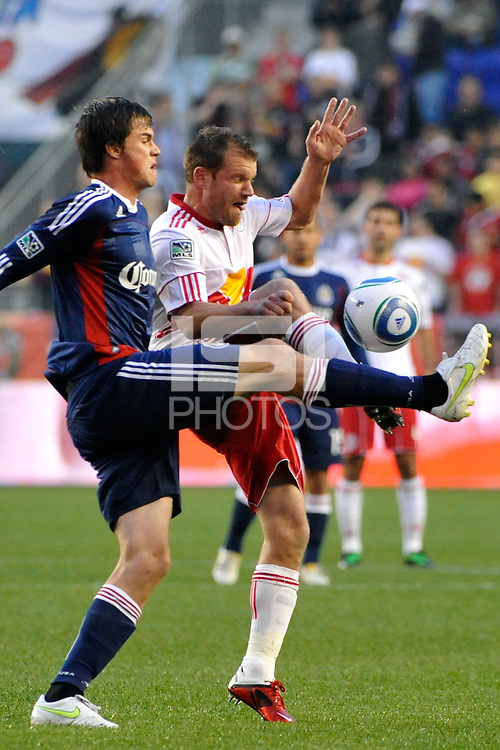 Justin Braun (17) of CD Chivas USA and Teemu Tainio (2) of the New York Red Bulls battle for the ball. CD Chivas USA defeated the New York Red Bulls 3-2 during a Major League Soccer (MLS) match at Red Bull Arena in Harrison, NJ, on May 15, 2011.