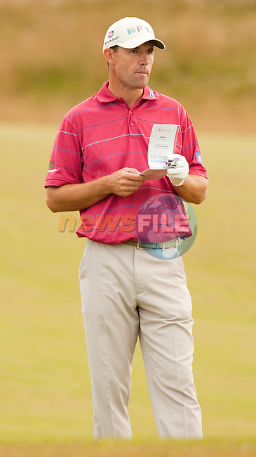 Padraig Harrington checks his yardages during the second round  of the Barclays Scottish Open, played over the links at Castle Stuart, Inverness, Scotland from 7th to 10th July 2011:  Picture Stuart Adams /www.golffile.ie 8th July 2011