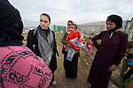 Sabeen Abdulsater (second from left), project officer for the Bekaa Valley for International Orthodox Christian Charities, talks with women refugees from Syria in the village of Jeb Jennine, Lebanon.