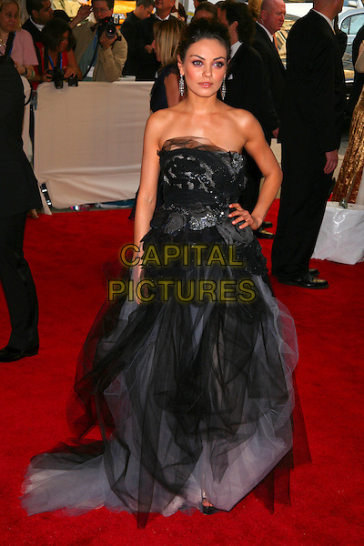 "MILA KUNIS .attending the Metropolitan Museum of Art's Costume Institute Gala ""American Woman: Fashioning A National Identity"" held at the Metropolitan Museum of Art, New York, NY, USA, May 3rd, 2010..full length strapless black tulle grey gray dress long maxi gown hand on hip layered layers silk chiffon                                     .CAP/LNC/TOM.©LNC/Capital Pictures."
