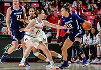 COLLEGE PARK, MD - JANUARY 26: Taylor Mikesell #11 of Maryland holds off Veronica Burton #12 of Northwestern during a game between Northwestern and Maryland at Xfinity Center on January 26, 2020 in College Park, Maryland.