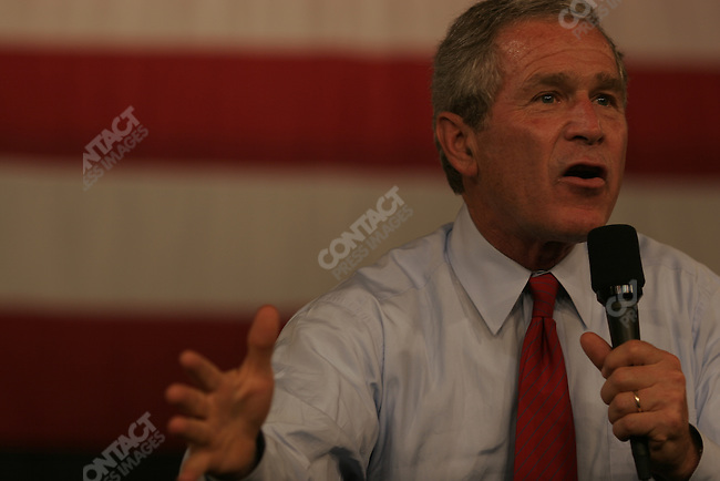 President George W. Bush arrives in Rochester MN where he addresses local supporters, and urges them to work hard for his campaign. Rochester, MN, October 20, 2004..