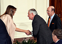 First lady Melania Trump, left, shakes hands with US Secretary of State Rex Tillerson, center prior to United States President Donald J. Trump arriving to announce he will name Principal Deputy White House Chief of Staff Kirstjen Nielsen as Secretary of Homeland Security in the East Room of the White House in Washington, DC on Thursday, October 12, 2017.  Looking on from right is US Secretary of Commerce Wilbur Ross.  If confirmed, Nielsen will replace Acting US Secretary of Homeland Security Elaine C. Duke, who has been in that position since General John F. Kelly, USMC (Retired) resigned to become White House Chief of Staff.<br /> Credit: Ron Sachs / CNP /MediaPunch