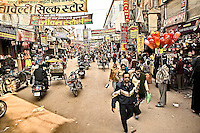 Shoppers and Vendors in the street market of Varanasi.<br /> (Photo by Matt Considine - Images of Asia Collection)