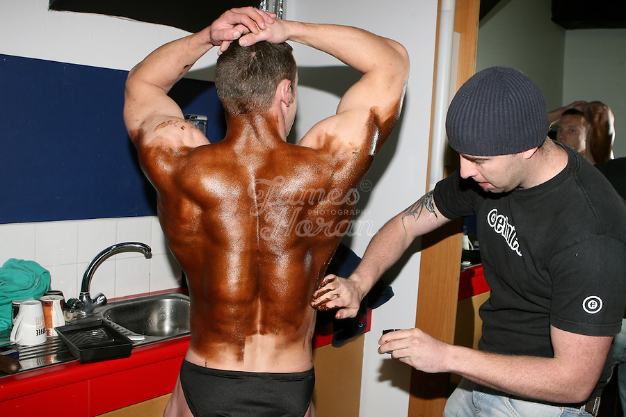 A competitor is pictured having his fake tan applied backstage at the RIBBF (Republic of Ireland Body Building Federation) National Championships held in Limerick at the Millennium Theatre, LIT, Ireland