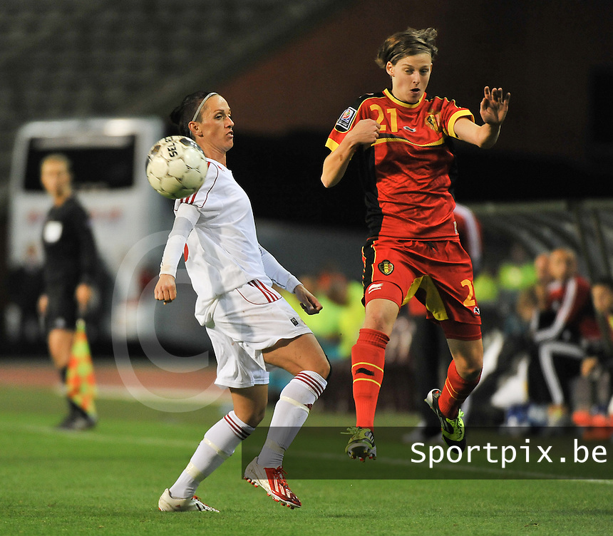 20130921 - BRUSSELS , BELGIUM : Belgian Yana Daniels (right) pictured in a fight for the ball with Albanian Seranaj Aurora (left) during the female soccer match between Belgium and Albania , on the first matchday in group 5 of the UEFA qualifying round to the FIFA Women World Cup in Canada 2015 at the Koning Boudewijn Stadion , Brussels . Saturday 21th September 2013. PHOTO DAVID CATRY