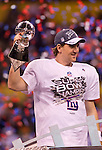 New York Giants Eli Manning (10) holds up the Vince Lombardi Trophy after beating the New England Patriots during the NFL Super Bowl XLVI football game on Sunday, Feb. 5, 2012, in Indianapolis. The Giants won 21-17 (AP Photo/David Stluka)...