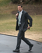 White House Personal Aide to the President John McEntee walk to Marine One to accompany United States President Donald J. Trump from the White House in Washington, DC for a trip to Mar-a-Lago, Florida for the week-end on Friday, February 16, 2018.<br /> Credit: Ron Sachs / CNP