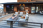 Patio area with outdoor dining table and firepit with comfortable seating