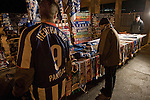 Home fans congregating around souvenir and refreshment stalls outside the stadium before Hertha Berlin's match against  Sporting Lisbon at the Olympic Stadium in Berlin in the group stages of the UEFA Europa League. Hertha won the match by 1 goal to nil to press to the knock-out round of the cup. 2009/10 was the the first year in which the Europa League replaced the UEFA Cup in European football competition.
