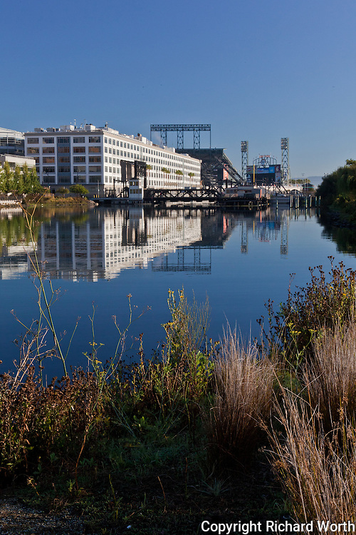 AT&T Park in the distance, a bit closer is the 4th Street Bridge,  from a path through Mission Creek Park in San Francisco.