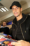 OIC - ENTSIMAGES.COM -Rio Ferdinand signs his new book at WHSmith in the Arndale centre manchester . 12.12.13, Photo by Christopher Foster /OIC 0203 1741069
