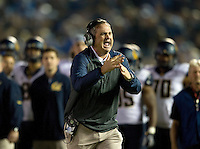 California head coach Sonny Dykes calls a time-out to the side judge during the game against UCLA at Rose Bowl in Pasadena, California on October 12th, 2013.   UCLA defeated California, 37-10.