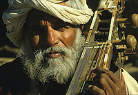 Musician using a Sitar instrument