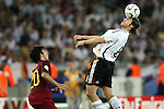08 July 2006: Torsten Frings (GER) (8) leans back to head a ball as Deco (POR) (20) looks on. Germany defeated Portugal 3-1 at the Gottlieb-Daimler Stadion in Stuttgart, Germany in match 63, the third-place game, of the 2006 FIFA World Cup.