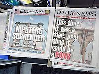 Both The New York Daily News and the New York Post on Wednesday, July 23, 2014 feature coverage of the previous days replacement of two American flags with bleached white flags on the towers of the Brooklyn Bridge. Despite numerous security measures by the NYPD the pranksters managed to mount the bridge towers and replace the flags with any police or witnesses.  (© Richard B. Levine)