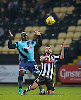 Adebayo Akinfenwa of Wycombe Wanderers & Richard Duffy of Notts Co during the Sky Bet League 2 match between Notts County and Wycombe Wanderers at Meadow Lane, Nottingham, England on 10 December 2016. Photo by Andy Rowland.