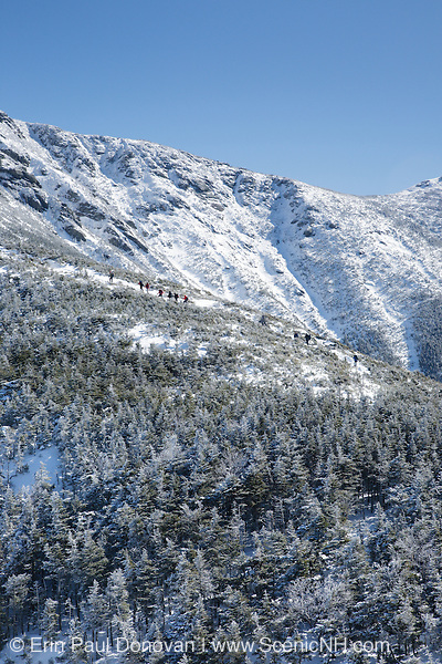 Hikers ascend the Greenleaf Trail to the summit of Mount Lafayette in the White Mountains of New during the winter months.