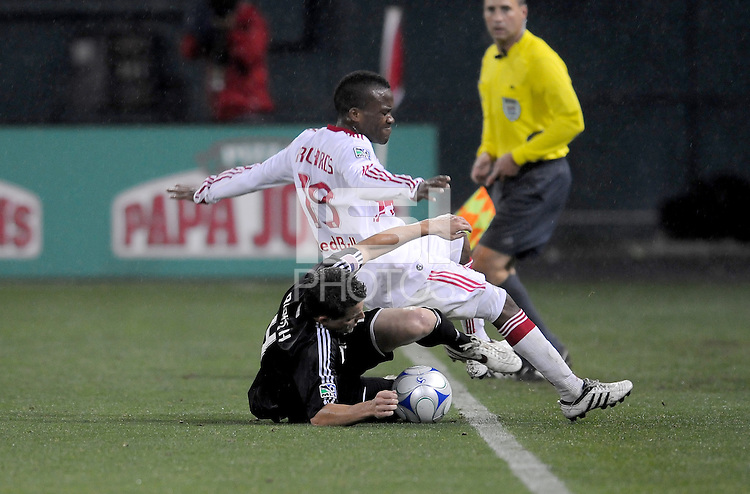 DC United defender Marc Burch (4) defends the play against New York Red Bulls forward Dane Richards (19)  DC United defeated the New York Red Bulls 2-0, at RFK Stadium ,Thursday June 4, 2009.