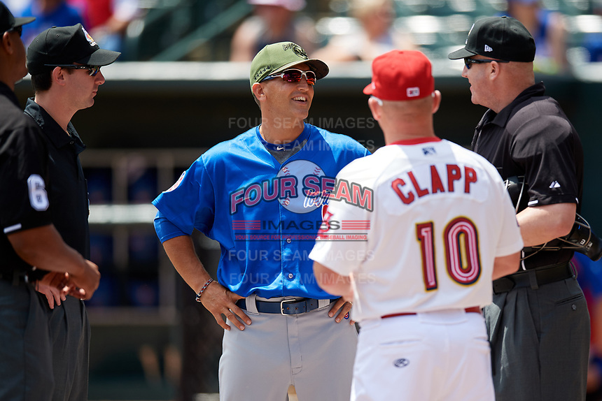 Iowa Cubs Andy Haines meets with Memphis Redbirds manager Stubby Clapp (10) and the umpiring crew before a game against the Memphis Redbirds on May 29, 2017 at AutoZone Park in Memphis, Tennessee.  Memphis defeated Iowa 6-5.  (Mike Janes/Four Seam Images)
