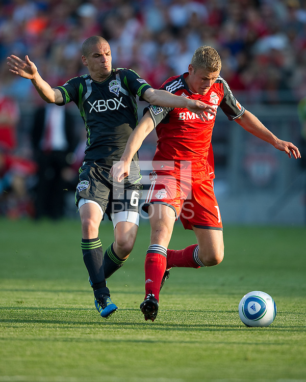 Seattle Sounders FC midfielder Osvaldo Alonso #6 and Toronto FC forward Nick Soolsma #18 in action during an MLS game between the Seattle Sounders FC and the Toronto FC at BMO Field in Toronto on June 18, 2011.