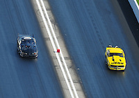 Apr. 28, 2012; Baytown, TX, USA: Aerial view of NHRA pro mod driver Leah Pruett (left) alongside Troy Coughlin during qualifying for the Spring Nationals at Royal Purple Raceway. Mandatory Credit: Mark J. Rebilas-