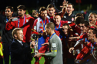 NZ minister of Sport and Recreation, Jonathan Coleman, presents the FIFA UNder-20 trophy to Serbia captain Predrag Rajkovic after the FIFA Under-20 Football World Cup Final between Brazil (gold) and Serbia at North Harbour Stadium, Albany, New Zealand on Saturday, 20 June 2015. Photo: Dave Lintott / lintottphoto.co.nz