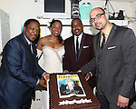 "Audra McDonald with Musicians Shelton Becton, George Farmer, and Clayton Craddock backstage at ""Lady Day At Emerson's Bar And Grill"" celebrating 100  Broadway Performances  at Circle in the Square on July 2, 2014 in New York City."