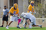 Los Angeles, CA 02-26-17 - Andrew Ferguson (UCSB #14), Jimmy Barlupo (UCSB #5) and Givino Rossini (Loyola Marymount #7) in action during the MCLA conference game between LMU and UC Santa Barbara.  Santa Barbara defeated LMU 15-0.