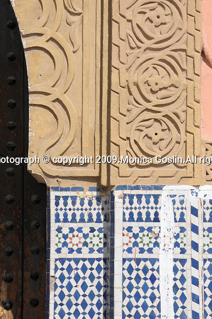 A column outside of a Mosque in Marrakesh, Morocco with blue and white tiles..