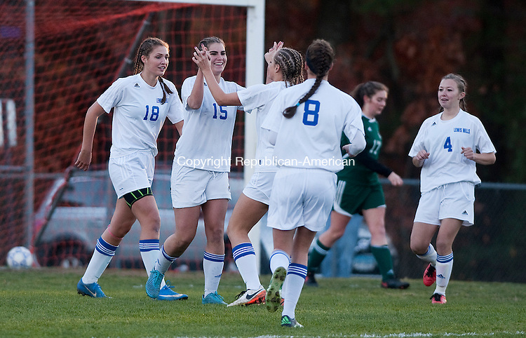 BURLINGTON,  CT-110716JS15- Lewis Mills' Julia Robillard  (15) is congratulated by teammates after scoring in the first half of  during their first round Class M tournament game against Griswold Monday at Nassahegan Field in Burlington. . <br /> Jim Shannon Republican American