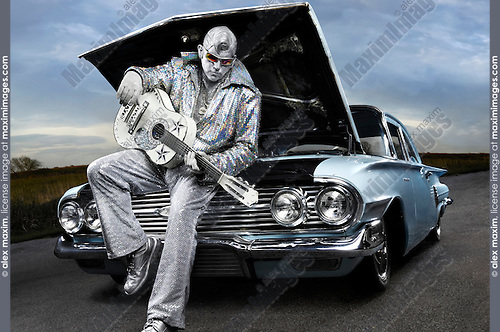 silver elvis with a guitar stock photo fashion commercial fine art stock photo archive. Black Bedroom Furniture Sets. Home Design Ideas