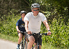 August 15, 2017; University of Notre Dame President Rev. John I. Jenkins, C.S.C., bikes on day 2 of the ND Trail to Pimento, Indiana. As part of the University's 175th anniversary celebration, the Notre Dame Trail will commemorate Father Sorin and the Holy Cross Brothers' journey. A small group of pilgrims will make the entire 300+ mile journey from Vincennes to Notre Dame over  two weeks. (Photo by Barbara Johnston/University of Notre Dame)
