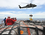 SOUTH CHINA SEA (March 12, 2011) Sailors aboard the U.S. 7th Fleet command ship USS Blue Ridge (LCC 19) stand-by to move pallets of humanitarian relief supplies across the ship's flight deck during an underway replenishment with the Military Sealift Command fleet replenishment oiler USNS Rappahannock (T-AO 204), not pictured. Blue Ridge is ensuring the crew is ready if directed to assist with earthquake and tsunami relief operations in Japan. (Photo by U.S. Navy/AFLO) [0006]