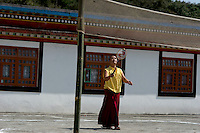 Buddhist  monk playing badminton in Sikkim India