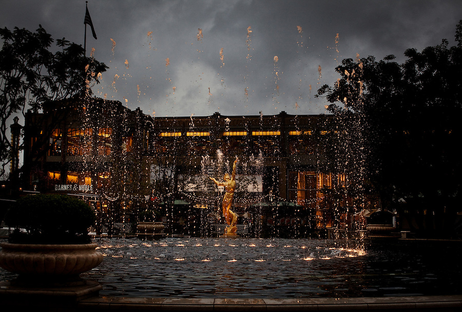 Glendale, California, February 18, 2011 - A view of the animated fountain designed by WET at the American at Brand. The Golden Key Hotel is surrounded on three sides by the Americana at Brand outdoor shopping mall. The Americana is looking to expand into the space where the hotel sits. The City Council is set to vote on Tuesday on the proposed expansion. City Council officials have said that if they can't cut a deal with the hotel owner, the city will likely use its eminent domain powers to seize the property.The Americana at Brand is owned by real estate developer Caruso Affiliated, which also owns The Grove at Farmers Market in Los Angeles. It is an open space shopping complex and living facility, with 75 retail shops, 19 restaurants,100 condominiums and 238 apartments and an animated fountain. .