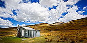 Under cotton wool clouds a Nevis Valley hut is a welcome sight for the  musterers of the golden hills. .This New Zealand Fine Art Landscape Print, available in four sizes on either archival Hahnemuhle Fine Art Pearl paper or canvas, is printed using Epson K3 Ultrachrome inks and comes with a lifetime guarantee against fading..All prints are signed and numbered on the lower margin and come with my 100% money back guarantee on the purchase price, should you not be  completely happy with the quality of the delivered print or canvas.