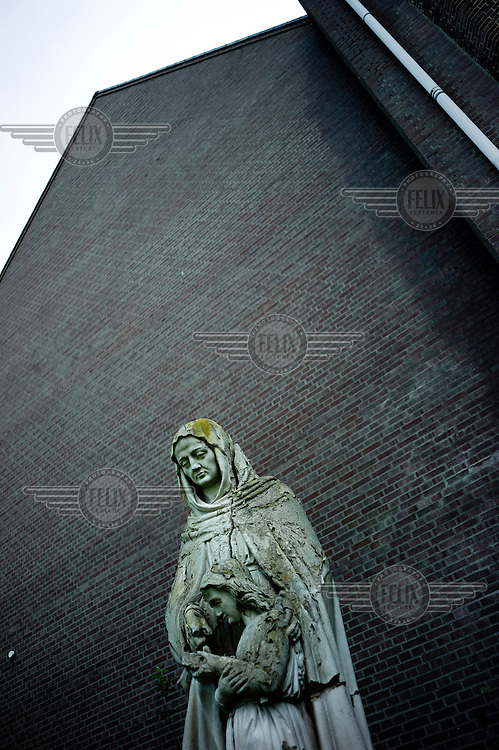 A statue of a mother and child outside the Saint Anna former cloister and boarding school in the town of Heel..