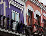 Wooden balconies on olorfully painted houses in the historic colonial city of Old San Juan, Puerto Rico.