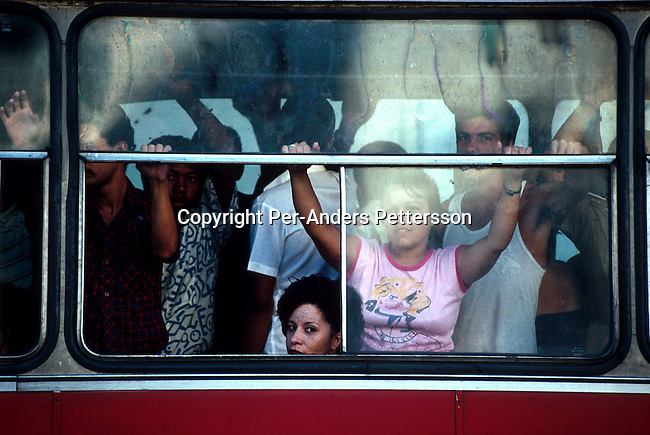 Commuters cramped in a buss on July 6, 1993 in central Havana, Cuba. The country have seen a severe drop in economic growth since the expiration of aid from the former Sovietunionen after the end of communism. Fidel Castro has ruled the communist island for over 4 decades and been in war of words with the United States all since then. They country has a good eduacation and medical level but lacks freedom of the press and speech. .(Photo: Per-Anders Pettersson/ Getty Images)