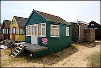 BNPS.co.uk (01202 558833)<br /> Pic: CorinMesser/BournemouthEcho/BNPS<br /> <br /> This beach hut at Mudeford Sand Spit is on the market for &pound;225,000, making it Britian's mst expensive beach hut. Public toilets are to the rear. <br /> <br /> Britain's most expensive beach hut has gone on the market for a whopping 225,000 pounds - and it doesn't even come with sea views.<br /> <br /> The wooden shack, that measures 13ft by 13ft, looks out onto sand dunes and offers  glimpses of the sea. It is also right next to a public toilet block.<br /> <br /> The timber hut on Mudeford Spit near Christchurch, Dorset, is divided up into three rooms - a living area, bedroom and a mezzanine level.<br /> <br /> It has no bathroom, mains electricity or running water and requires a ride on a novelty land train or a 30 minute walk to get there.