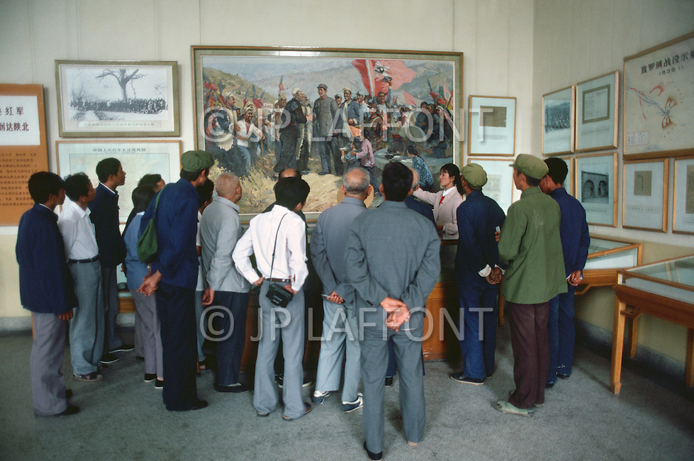 September, 1985. Shaanxi Province, China. The cave of Yan'an where Mao Zedong ended his Long March and stayed from 1937-1947 is now a museum. Museum visitors with museum collection.