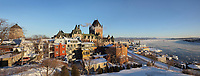 View of Upper Town, Quebec City and the Saint Lawrence river in winter, Quebec, Canada. On the left is the Chateau Frontenac, opened 1893, designed by Bruce Price as a chateau style hotel for the Canadian Pacific Railway company or CPR. The building was extended and the central tower added in 1924, by William Sutherland Maxwell. It is now a hotel, the Fairmont Le Chateau Frontenac, and is listed as a National Historic Site of Canada. The Historic District of Old Quebec is listed as a UNESCO World Heritage Site. Picture by Manuel Cohen