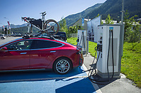 Switzerland. Canton Graubünden. Davos. Tesla car. On the parking place near Lake Davos, ABB EV charging solution for cars. Electric vehicle charging infrastructure. ABB lays the foundations for a future of smarter, reliable, and emission-free mobility, accessible by everyone, everywhere.  ABB offers a total ev charging solution from compact, high quality AC wallboxes, reliable DC fast charging stations with robust connectivity that meet the needs of the next generation of smarter mobility. ABB Ability connected chargers enable fast global service and pro-active maintenance. ABB has years of experience in creating, installing and maintaining charging infrastructure, including several nationwide charger networks. Tesla, Inc. (formerly Tesla Motors, Inc.) is an American electric vehicle.12.07.2020 © 2020 Didier Ruef