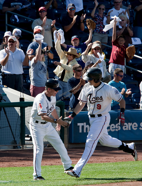 Reno Aces Mike Jacobs is congratulated by Manager Brett Butler after hitting a three run home run to break up a 3-3 tie in the bottom of the 7th inning against the Sacramento River Cats during their play off game played on Sunday afternoon, September 9, 2012 in Reno, Nevada.