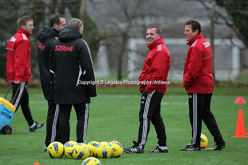 FAO SPORTS PICTURE DESK<br /> Pictured: Manager Brendan Rodgers (C) with coaches Alan Curtis (2nd L) and Colin Pascoe (R). Thursday 12 January 2012<br /> Re: Premier League football side Swansea City FC training session at Llandarcy, south Wales.